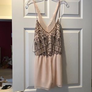 Silky and jeweled pink romper